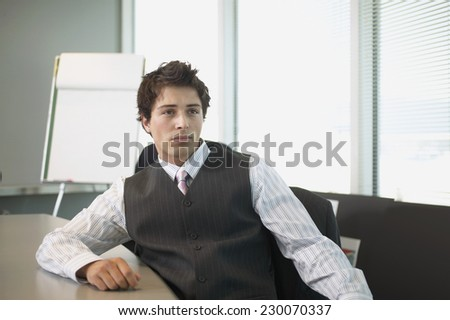 Portrait of a businessman posing for the camera in a conference room