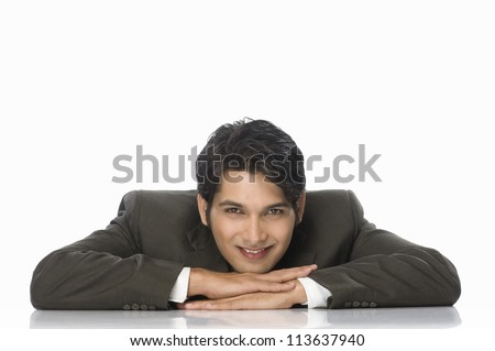 Portrait of a businessman resting his chin on his hands