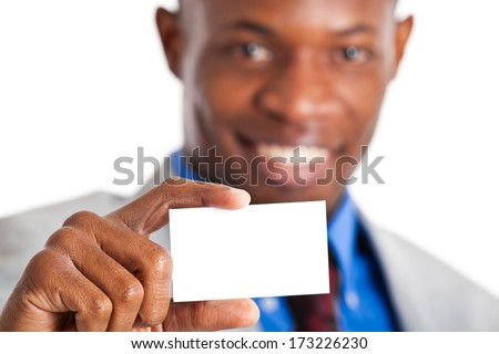 Portrait of a businessman showing a blank business card  - stock photo