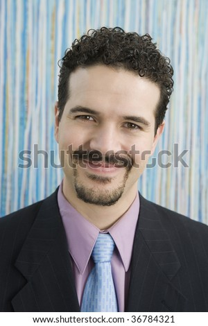 Portrait of a businessman smiling - stock photo