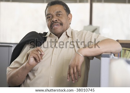 Portrait of a businessman standing in an office - stock photo