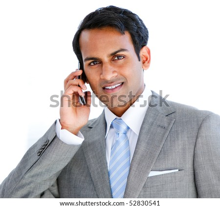 Portrait of a businessman taking a phone call in  the office - stock photo