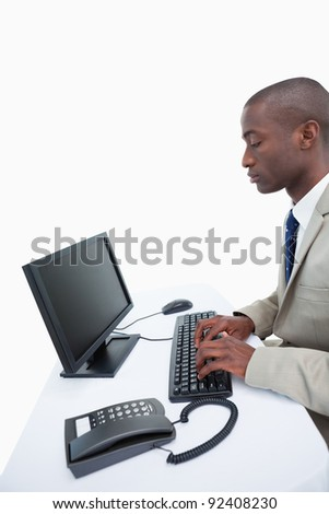 Portrait of a businessman using a computer against a white background