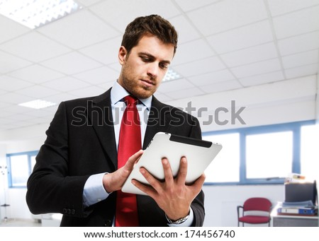 Portrait of a businessman using a tablet - stock photo