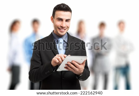 Portrait of a businessman using his tablet - stock photo