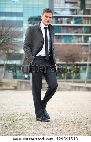 Portrait of a businessman walking in the city - stock photo