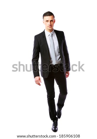 Portrait of a businessman walking isolated on a white background - stock photo