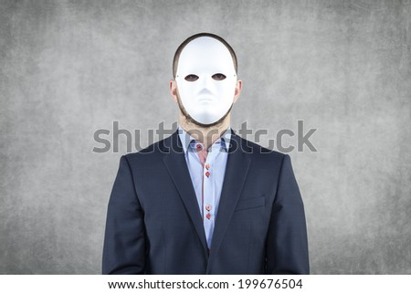 Portrait of a businessman wearing a mask - stock photo