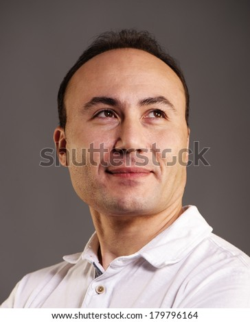 Portrait of a businessman who looks away in the studio on a dark background.