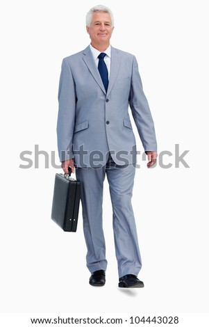 Portrait of a businessman with a suitcase walking against white background