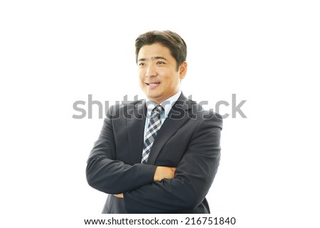 Portrait of a businessman with his arms crossed - stock photo
