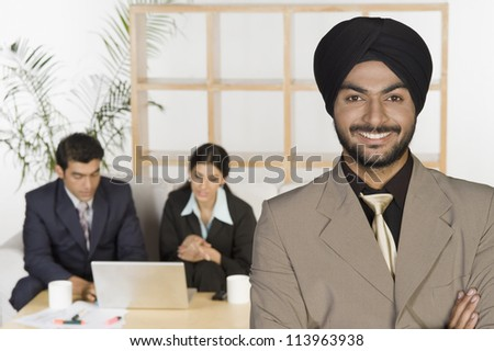 Portrait of a businessman with his colleagues in the background - stock photo