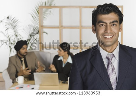 Portrait of a businessman with his colleagues in the background