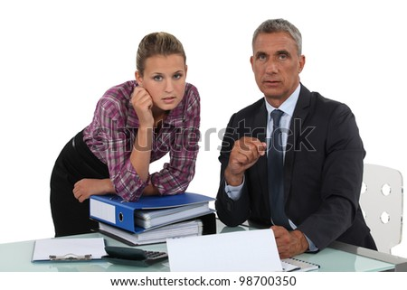 Portrait of a businessman with his secretary - stock photo