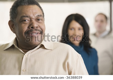 Portrait of a businessman with team - stock photo