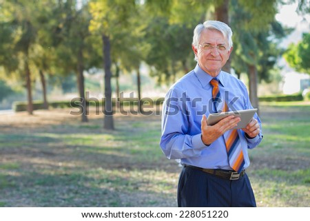 Portrait of a businessman working and holding a tablet.