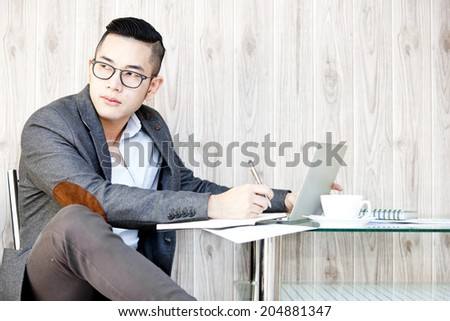 Portrait of a businessman working on computer