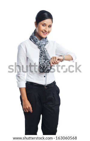 Portrait of a businesswoman checking the time and smiling - stock photo