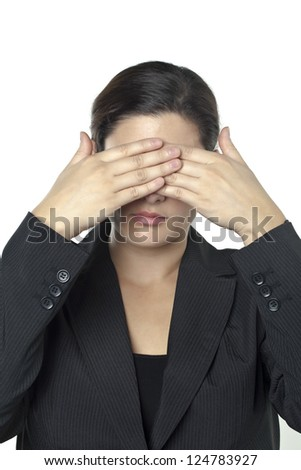 Portrait of a businesswoman covering her eyes using her hands