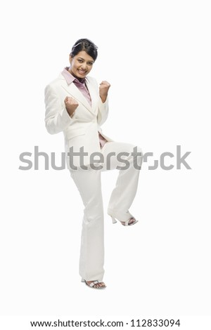 Portrait of a businesswoman exclaiming with joy - stock photo