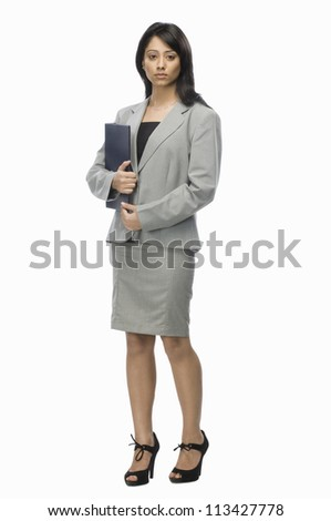 Portrait of a businesswoman holding a file - stock photo