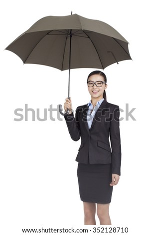 Portrait of a businesswoman holding under umbrella