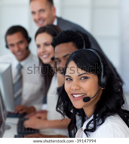 Portrait of a businesswoman in a call center with her multi-ethnic team