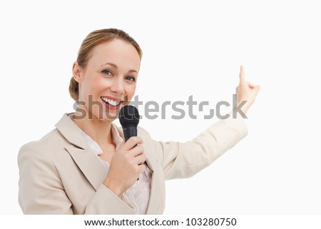 Portrait of a businesswoman in conference against white background - stock photo