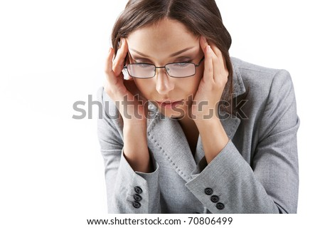 Portrait of a businesswoman in glasses rubbing her temples