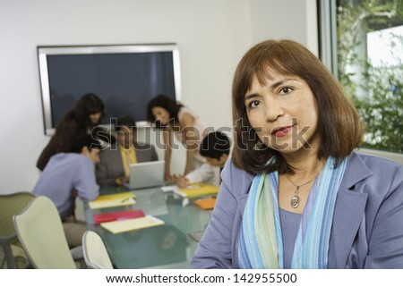 Portrait of a businesswoman in meeting room