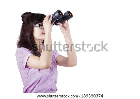 Portrait of a businesswoman searching for new job opportunities with binoculars.