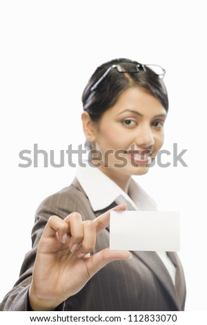 Portrait of a businesswoman showing a business card against a white background