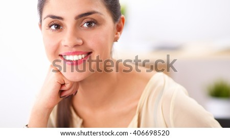Portrait of a businesswoman sitting at  desk in office