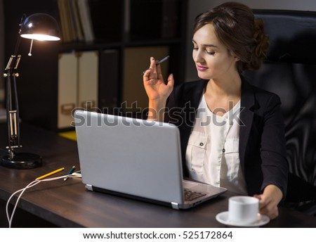 Portrait of a  businesswoman sitting at her workplace in office with cup of coffee