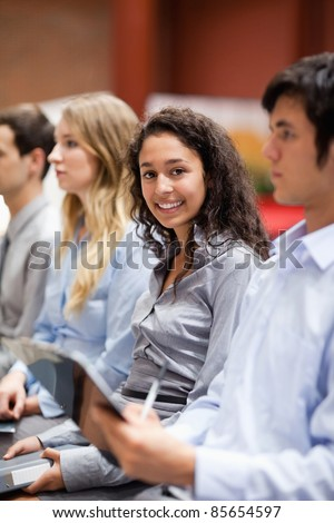 Portrait of a businesswoman smiling at the camera during a presentation - stock photo