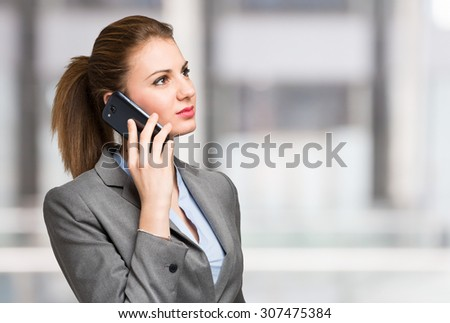 Portrait of a businesswoman talking on the phone - stock photo