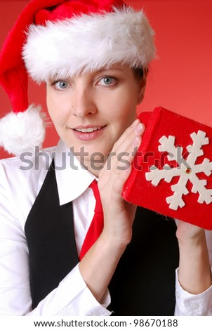 portrait of a businesswoman with santa hat and christmas gift