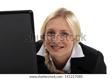 Portrait of a businesswoman working on her laptop - stock photo