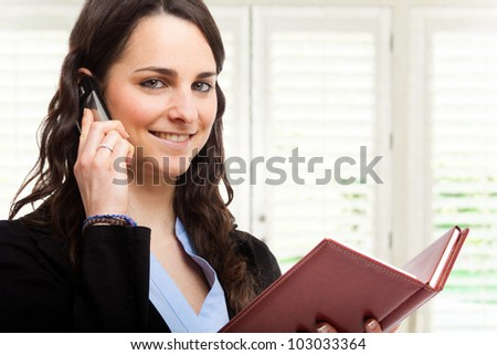 Portrait of a busy businesswoman at work - stock photo