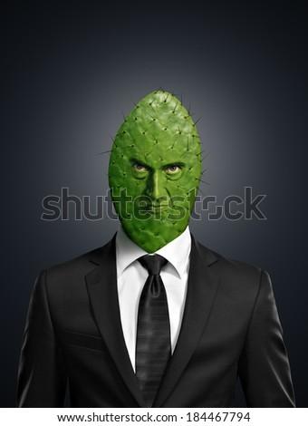 Portrait of a cactus head businessman - stock photo