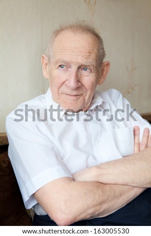 portrait of a calm senior man, he is looking somewhere - stock photo