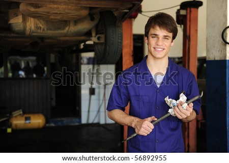 portrait of a car mechanic at work with copy space