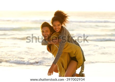 Portrait of a carefree couple enjoying the beach