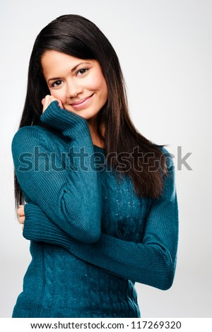 portrait of a casual attractive woman confident and sexy isolated on grey background - stock photo
