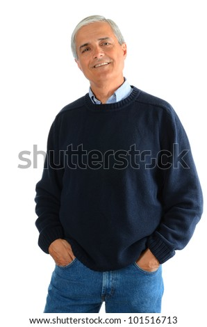 Portrait of a casual middle aged man wearing blue jeans and a sweater. Man has his hands in his pockets over a white background.