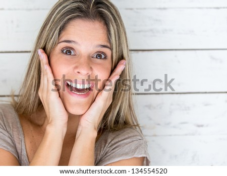 Portrait of a casual woman looking surprised - stock photo