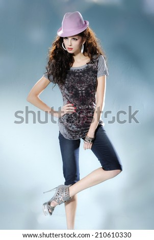 portrait of a casual young fashion in hat posing  - stock photo