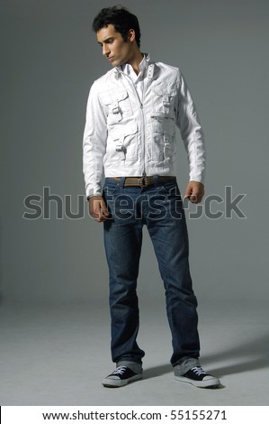 Portrait of a casual young satisfied man - stock photo