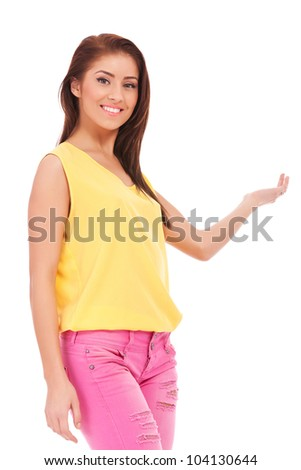 portrait of a casual young woman presenting something on white background
