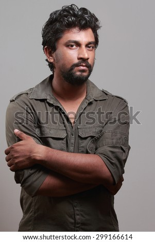 Portrait of a casually dressed sharp looking Indian young man - stock photo